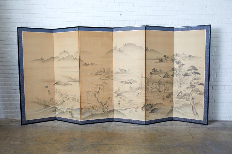 Large 18th century Japanese six panel Edo period screen depicting village farming and agricultural landscape scenes. Ink on paper painting signed from the brush of Fujiwara Morimasa with seal made in the Maruyama-Shijo school style. The screen