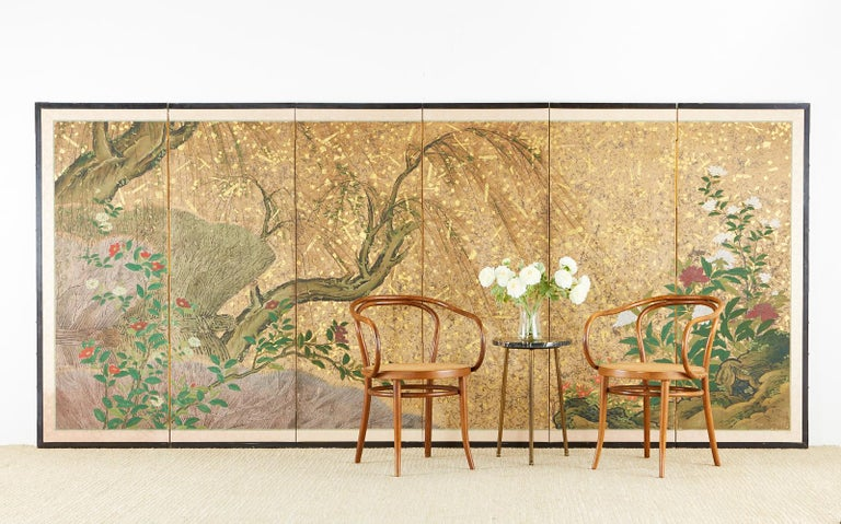 18th century Japanese Edo period six-panel screen featuring spring willow with camellia and peonies in a dramatic storm of silver and gold leaf flecks. Made in the Hasegawa school style with various sizes of silver and gold flecks appearing like a