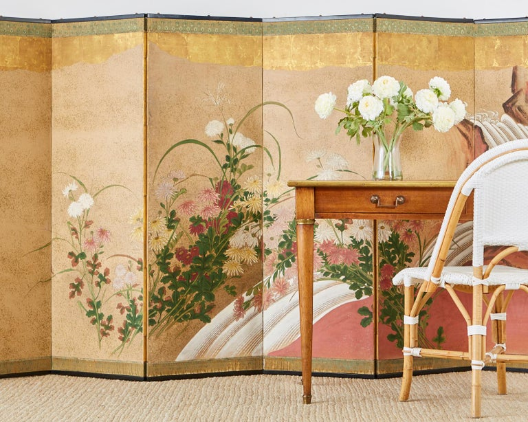 Impressive Japanese six panel Meiji period screen featuring chrysanthemums with a waterfall landscape behind. Late 19th century work with some Kano School influence. The white flowers are painted with a moriage technique (raised pigment). Ink and