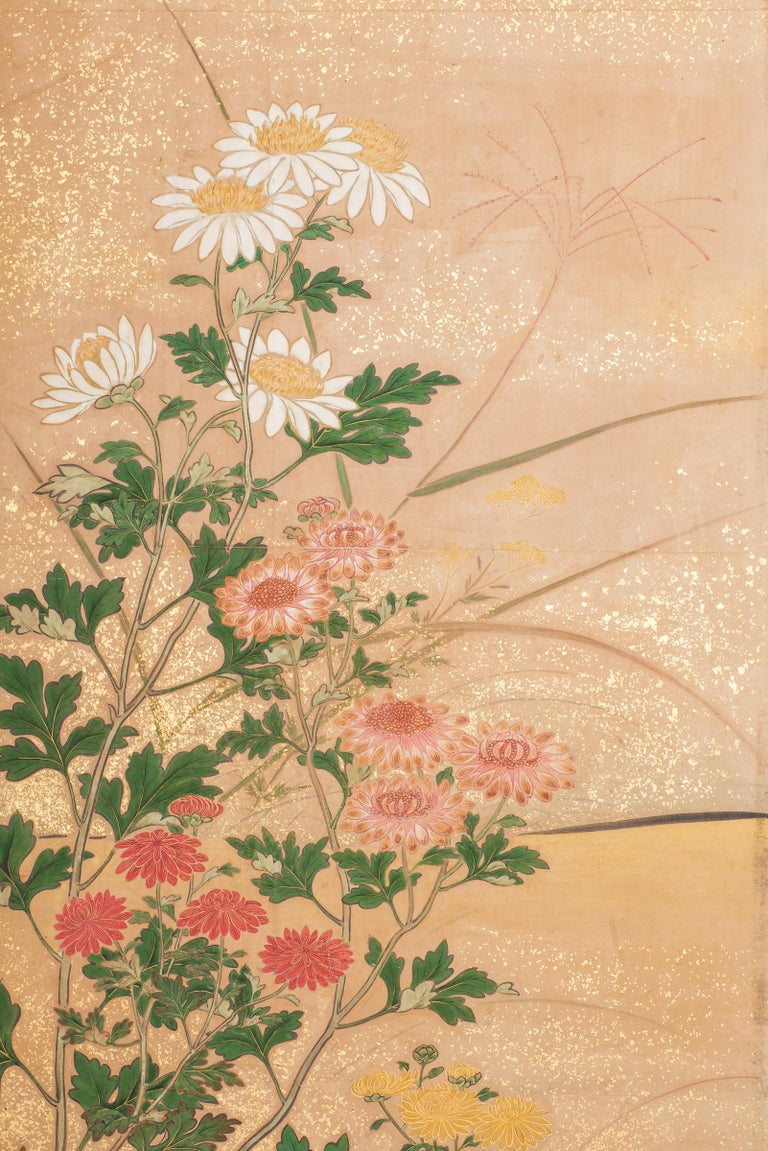 Japanese six-panel screen: Chrysanthemums, Edo period (circa 1800) painting of a variety of chrysanthemums in a garden landscape, with sparrows. Mineral pigments on paper with gold dust and a silk brocade border. Signature reads: Mutsu.