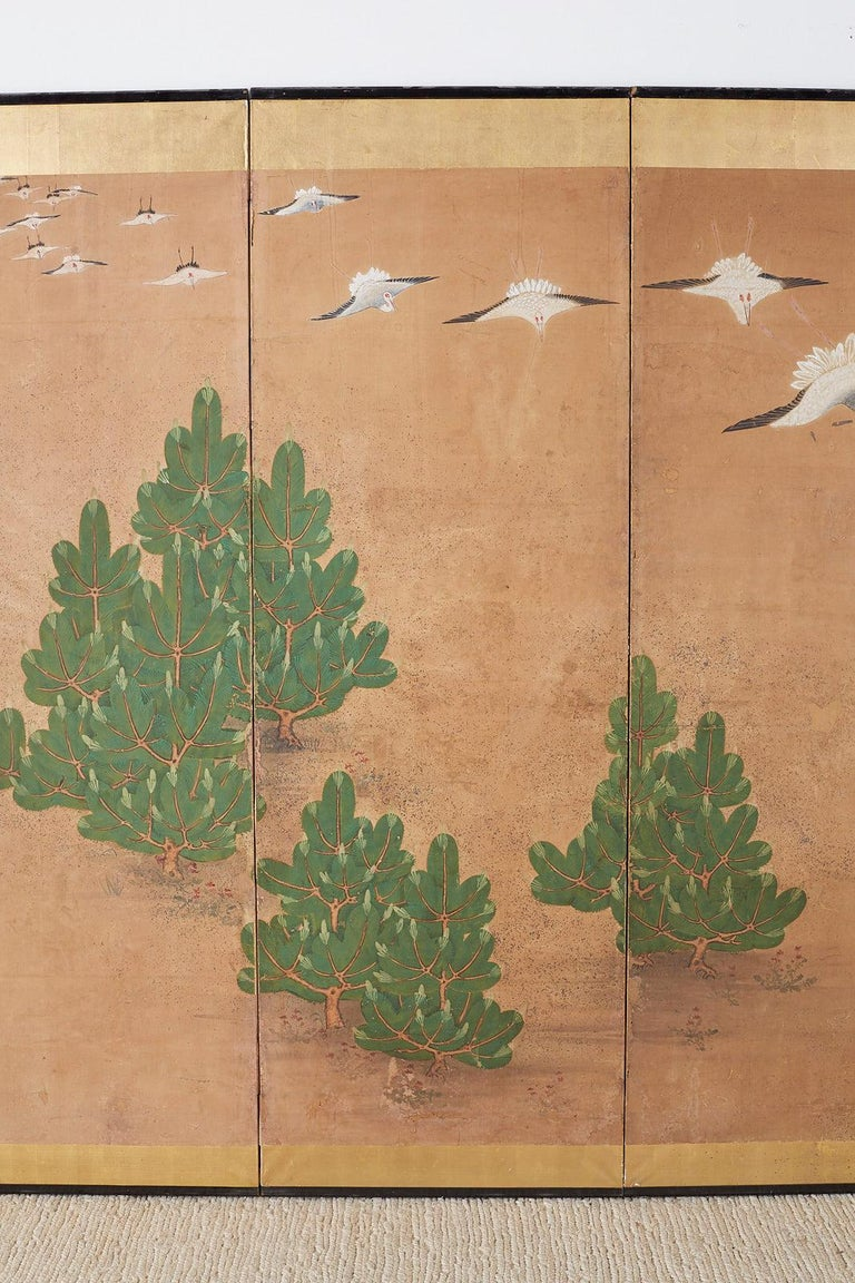 Lacquered Japanese Six-Panel Screen of Cranes in Flight For Sale