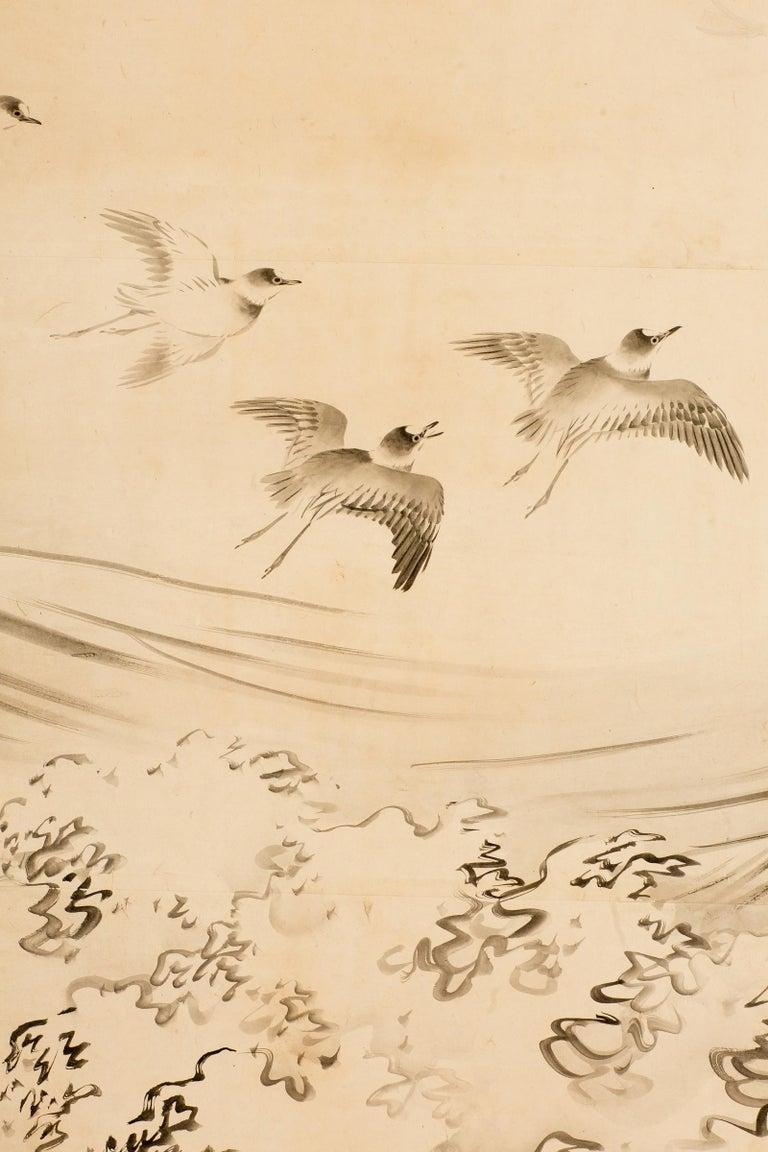 Japanese six-panel screen, open ocean, late Edo - early Meiji period, circa 1870, painting of plovers flying over cresting waves. Sumi ink on mulberry paper with a silk brocade border, good condition. Signature and seal read: Hayashi Ranga. One of a