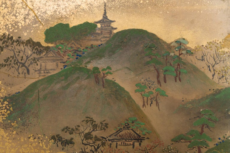 A mid-sized six panel screen. Edo period (c. 1800) painting of a landscape features a temple on the mountain top, a river with fishermen emerging from golden mist, and depicts farmers crossing a bridge between tree covered hills and mountains.