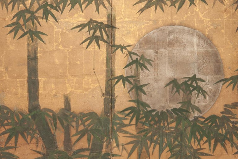 Japanese six-panel screen, silver moon and bamboo on gold, a silver leaf moon seen through a bamboo forest and low hanging gold leaf clouds. Mineral pigments painted on heavy gold leaf and mulberry paper. A small six-panel screen with a tranquil