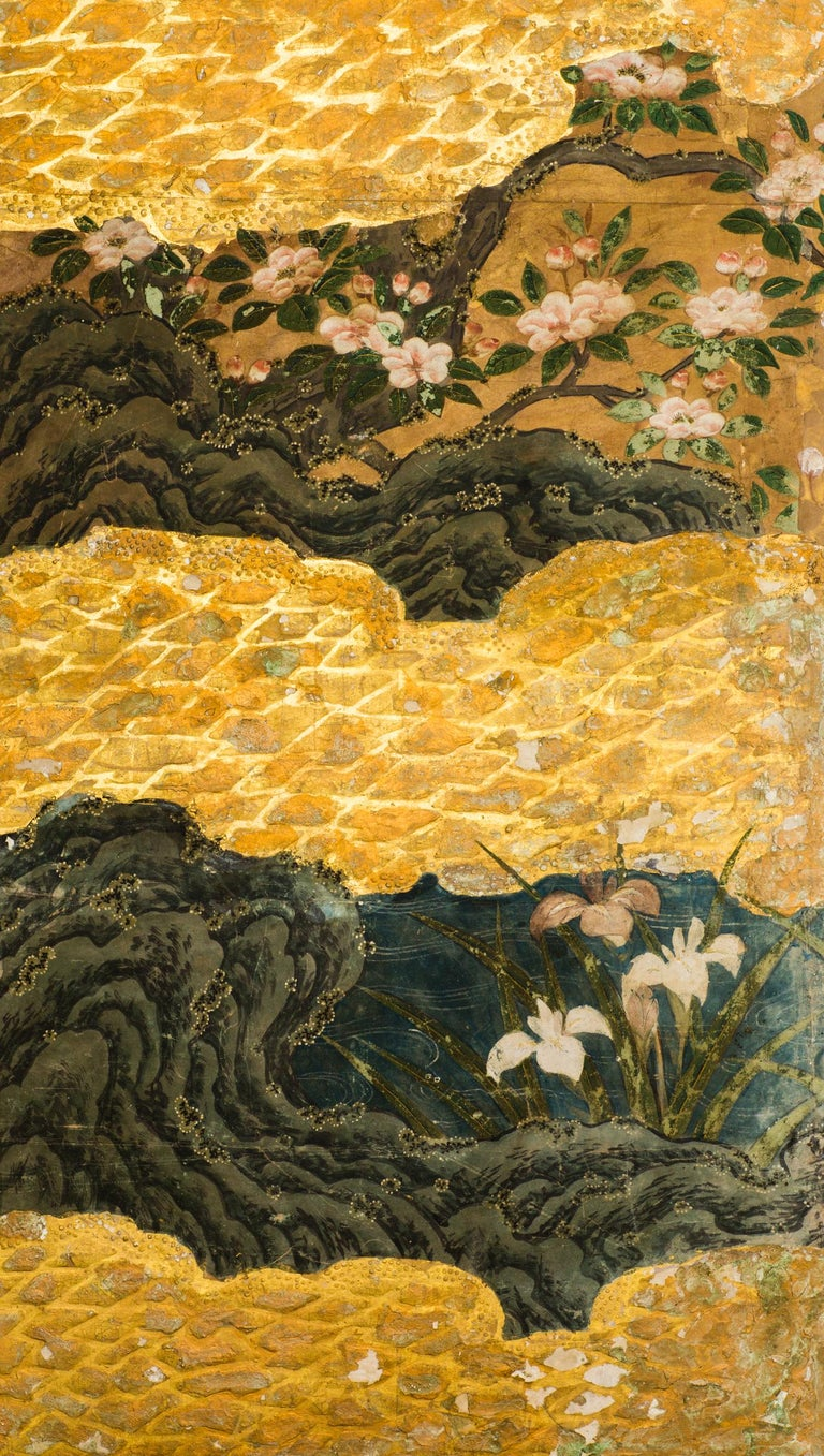 Mid-Edo period, 18th century painting with gold leaf and mineral pigments. A summer landscape depicting summer flowers and exotic birds, accented with an abstract cloud design. Mineral pigments, gofun, gold leaf on mulberry paper with a silk brocade