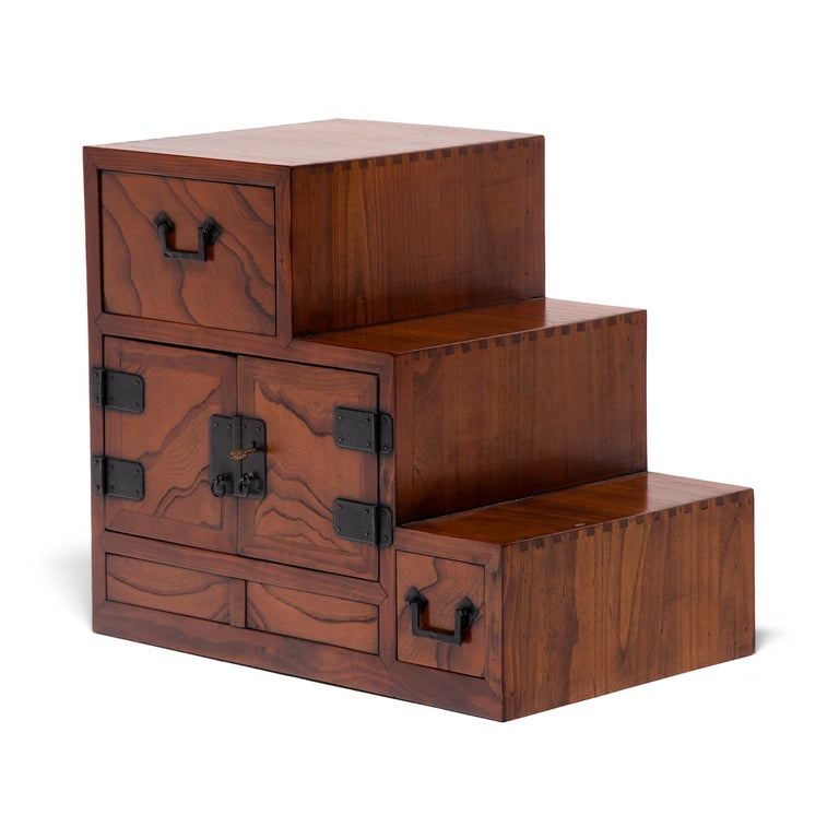 Designed to be versatile and portable, Japanese tansu chests were multipurpose storage cabinets that moved throughout the home as needed. This petite chest was originally the upper compartment of a large step tansu, known as kaidan-dansu, which