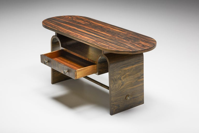 Elegant rosewood side/coffee table inspired by the principles of Japanese purity. The organic yet composed forms in combination with two small drawers offer space for books and other curiosities.