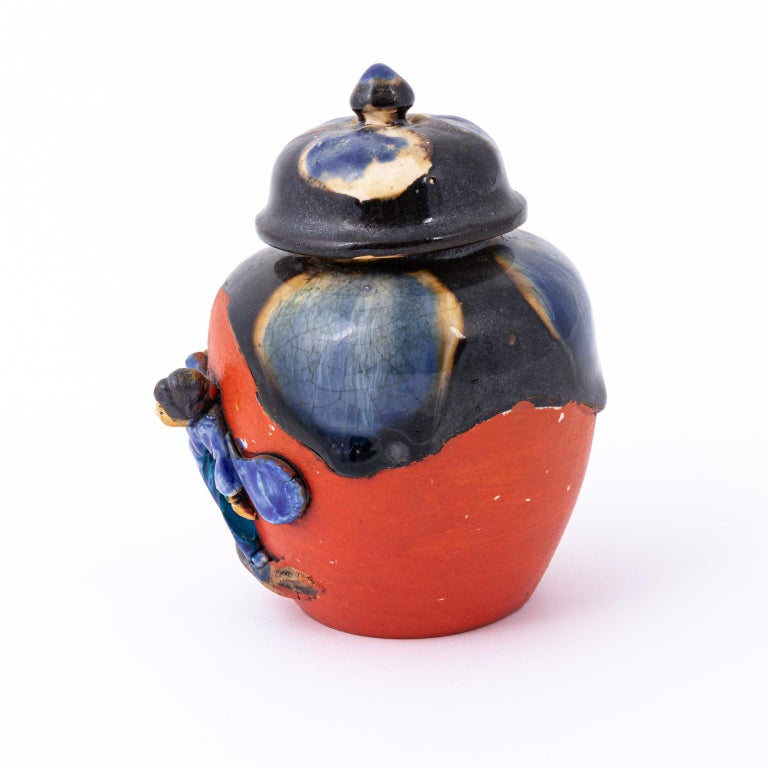 Sumida Gawa tea caddy, circa early 20th century. It features a three dimensional Japanese woman and has great glaze. Please note of wear consistent with antique age including some paint loss which is common on these pieces.
