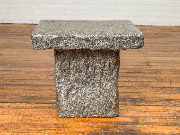 A Japanese Taisho period exterior stone garden seat from the early 20th century, with rustic appearance. Crafted in Japan during the first quarter of the 20th century, this Taisho period garden seat features a rectangular seat overhanging a