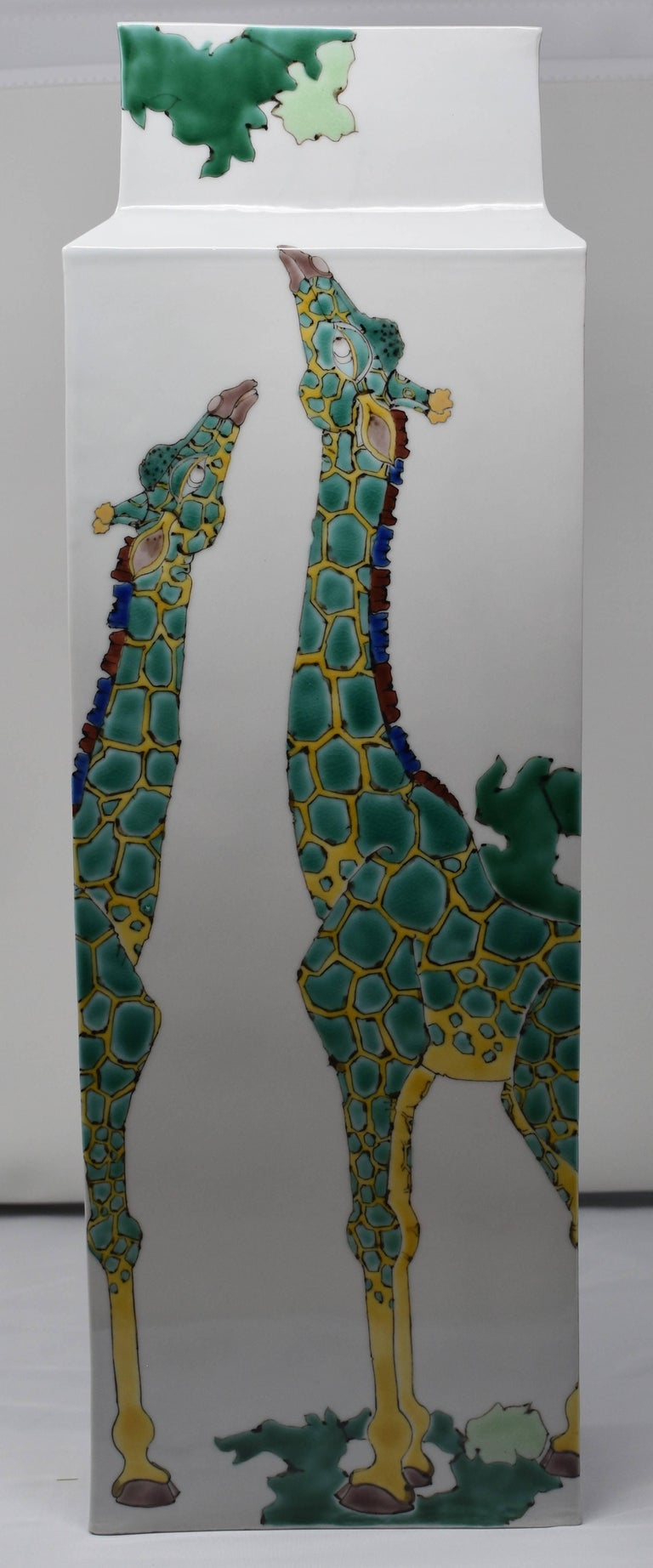 A contemporary large Japanese Kutani hand-painted porcelain vase with a unique interpretation of giraffes. This is part of a series of pieces featuring the animals of the African savannah. Depicted here are giraffes looking skyward and earthward