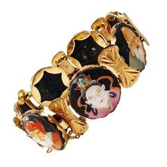 Japanese Toshikane Ari 7 Lucky Gods 18 Karat Gold Porcelain Bracelet circa 1940s