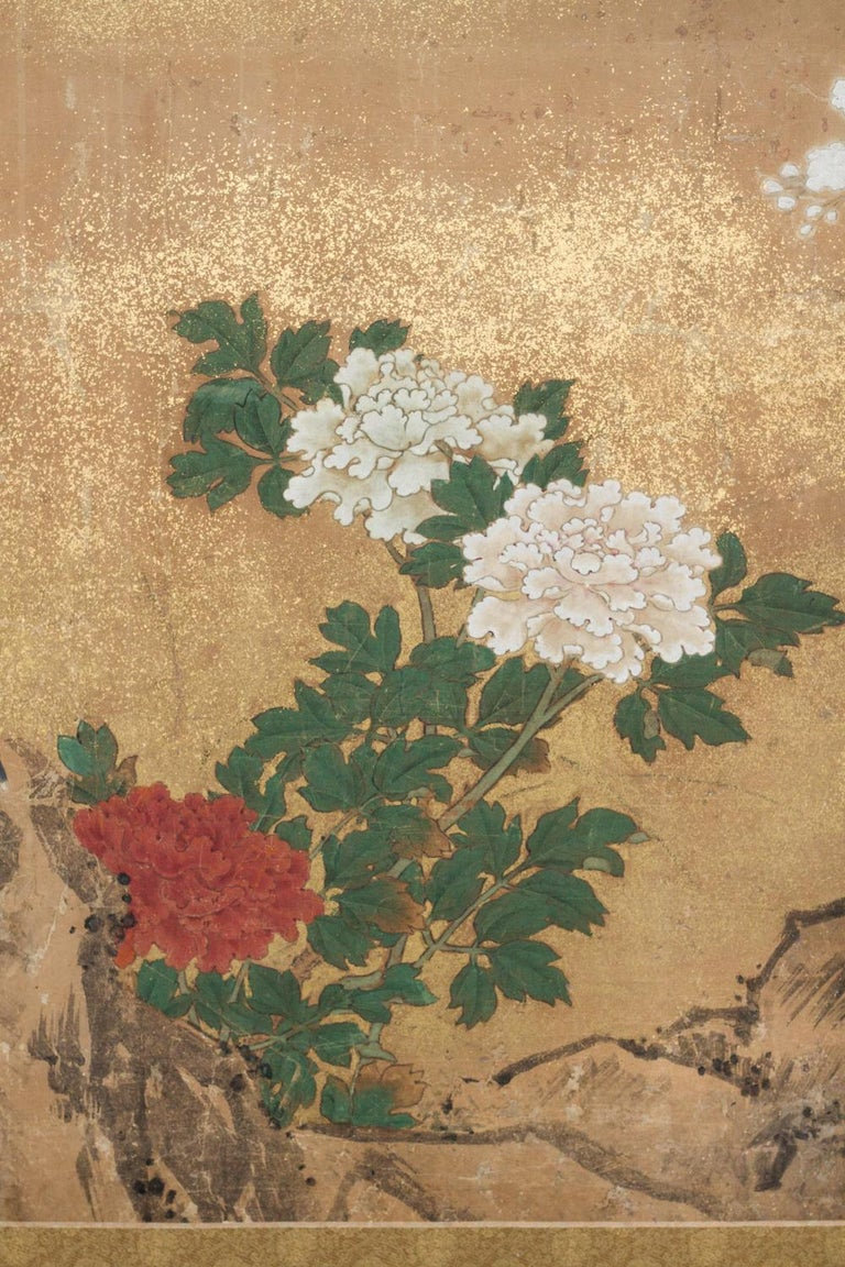 Japanese two-panel screen: Peony and Cherry, Edo period (circa 1800) painting, formerly fusuma (Japanese sliding doors), executed in the Kano school style, featuring a cherry tree in bloom, partially obscured by gold dust mist. A bird rests on the