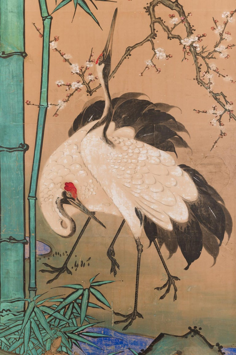 Japanese two panel screen: Amorous Cranes and Turtles. In Japan, cranes symbolize fidelity as they mate for life and turtles symbolize longevity. Additionally, this screen also has the Japanese motif of sho-chiku-bai, or the three friends of winter