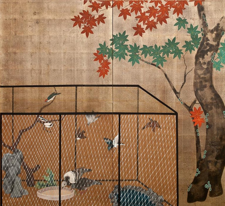 Japanese Two Panel Screen: Aviary Shaded By A Maple Tree, Showa period (1926 - 1989) painting of an outdoor bird enclosure under a maple tree. Painted in mineral pigments on mulberry paper with a silk brocade border.