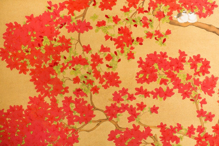 Beautifully painted Japanese two-panel screen with vibrant azalea tree with finches, camellia tree, and yellow azaleas. Mineral pigments and gold dust on gold silk background. Signature very stylized, best guess on the translation: Eison Utsushi.