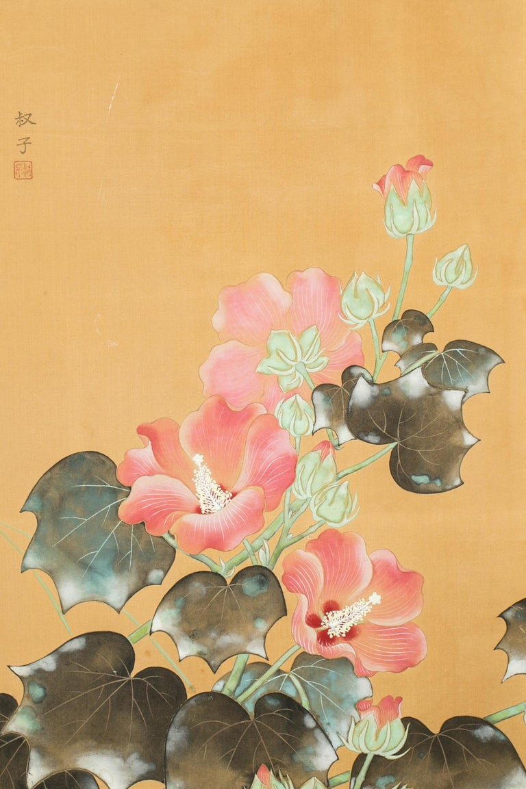 Japanese Two Panel Screen: Hibiscus in Bloom, Meiji period (1868 - 1912) painting of hibiscus flowers reaching for the sun in full bloom.  Mineral pigments on silk with a silk brocade border.  Signature and seal read: Toshiko.