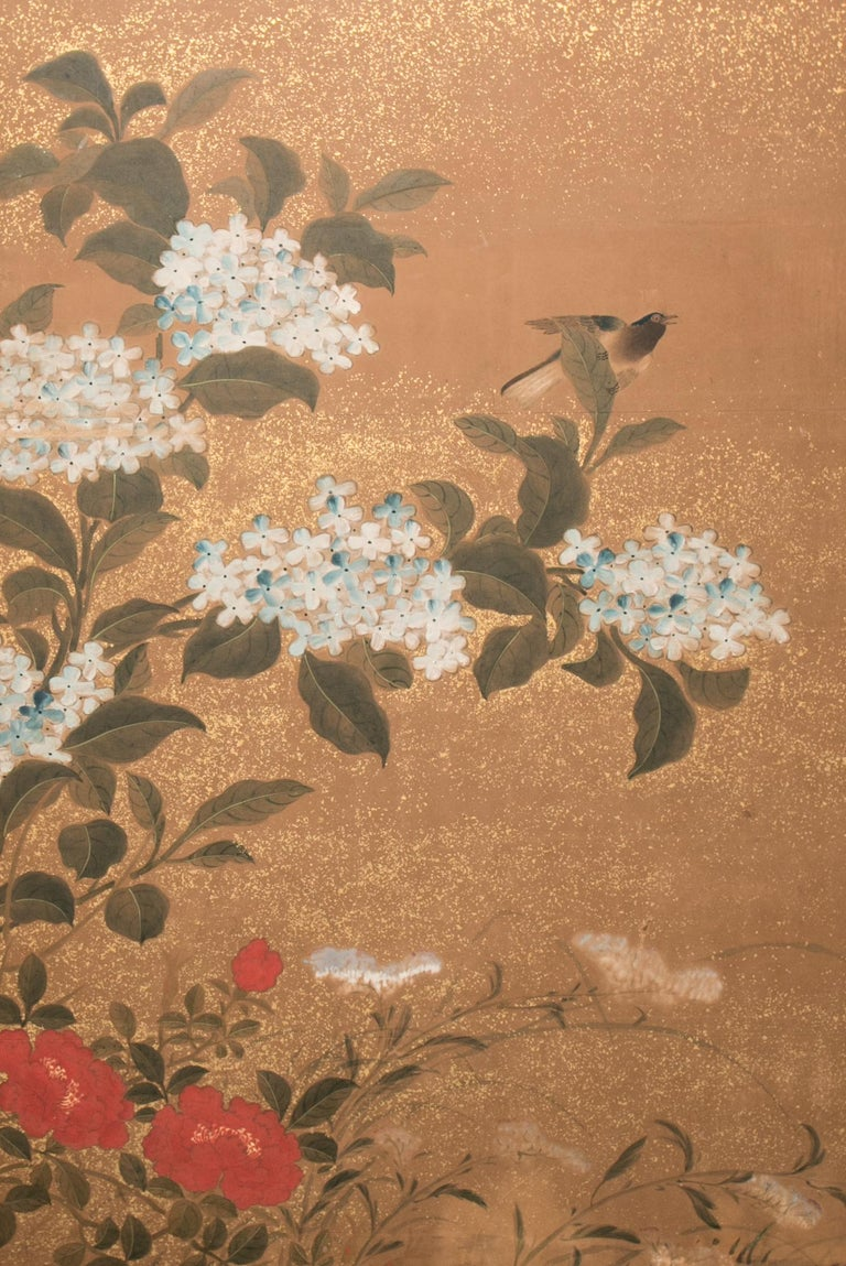 Meiji period (1868-1912) painting, with a lovely softness, celebrating spring. Painted in mineral pigments on mulberry paper with gold dust and a silk brocade border.