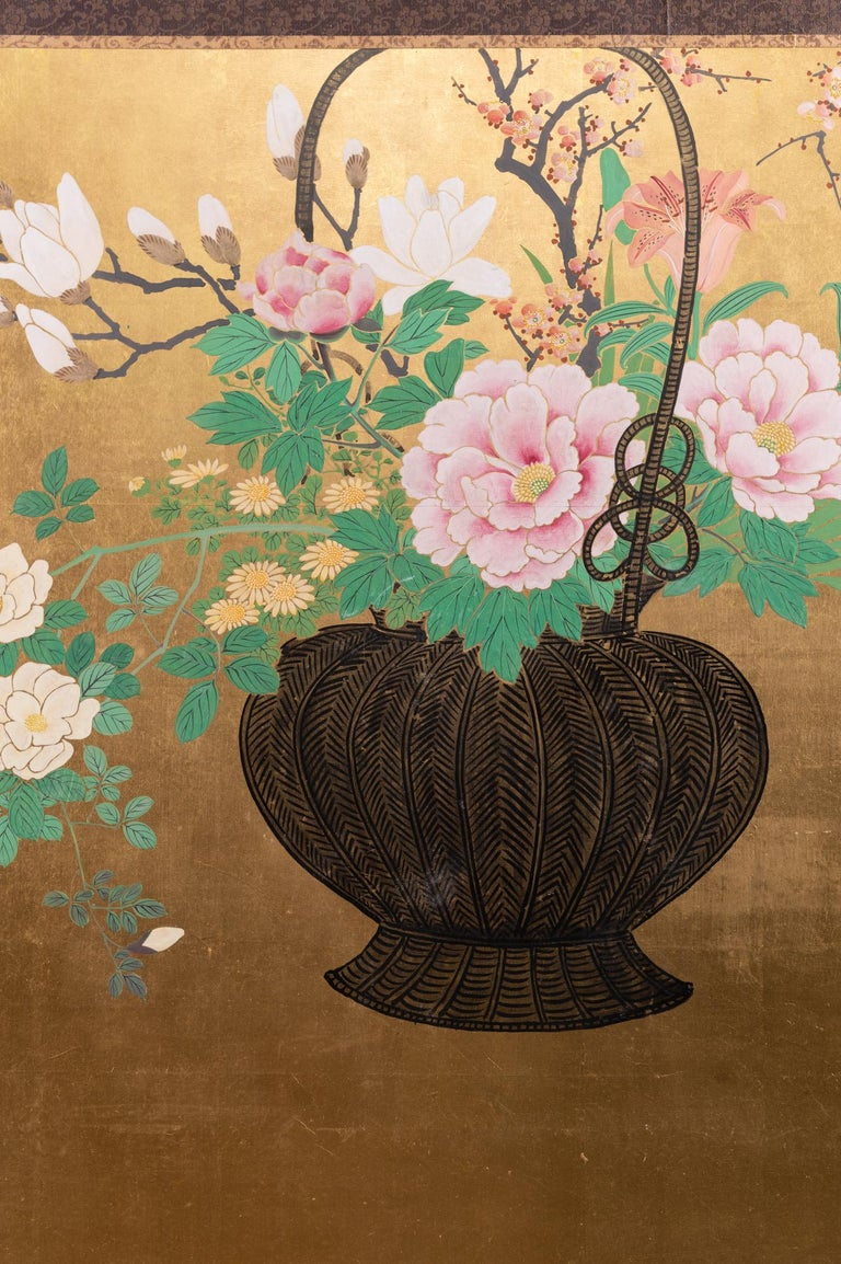 Japanese two-panel screen: Ikebana on gold. Meiji period (1868-1912) painting of a basket with beautifully arranged spring flowers in the style of ikebana (Japanese traditional flower arranging). Lovely use of negative space and composition. Mineral