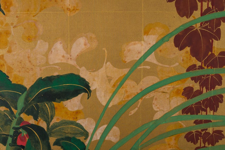 Japanese Two Panel Screen: Late Summer Into Fall, Taisho period (1912 - 1926) painting, featuring, hollyhocks, bellflowers, an autumn colored wood vine, chrysanthemums, and subtle falling ginko leaves in the background.  Painted in mineral pigments