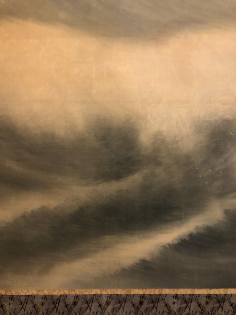 Japanese two panel screen: Moon Over Stormy Seas, Meiji period (1868-1912) soft painting in mineral pigments on silk in tones of blue, grey, and white. A wonderful study of a brewing storm. Signature and seal read: Seiko.