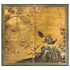 Japanese Two Panel Screen of a Tragopan Standing on Rocks by Plum Blossoms