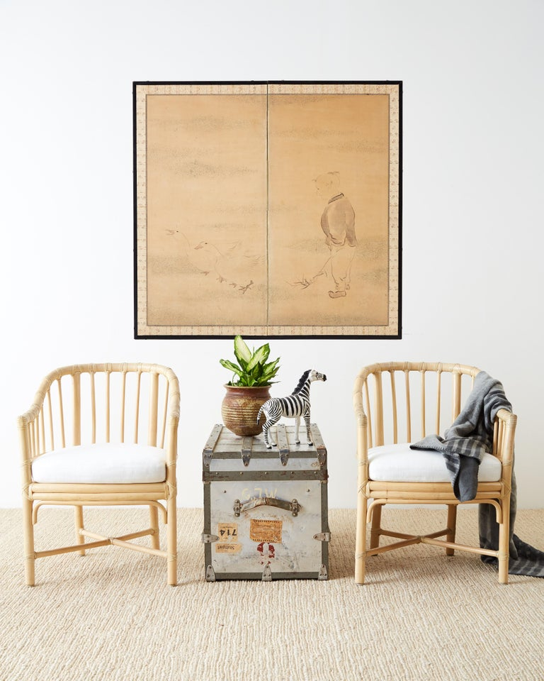 Interesting Japanese Meiji period two-panel Byobu screen depicting a child holding bamboo shoots and following a pair of geese. The faded landscape in the background once decorated with gold specs is now only remnants. The painting is set in an