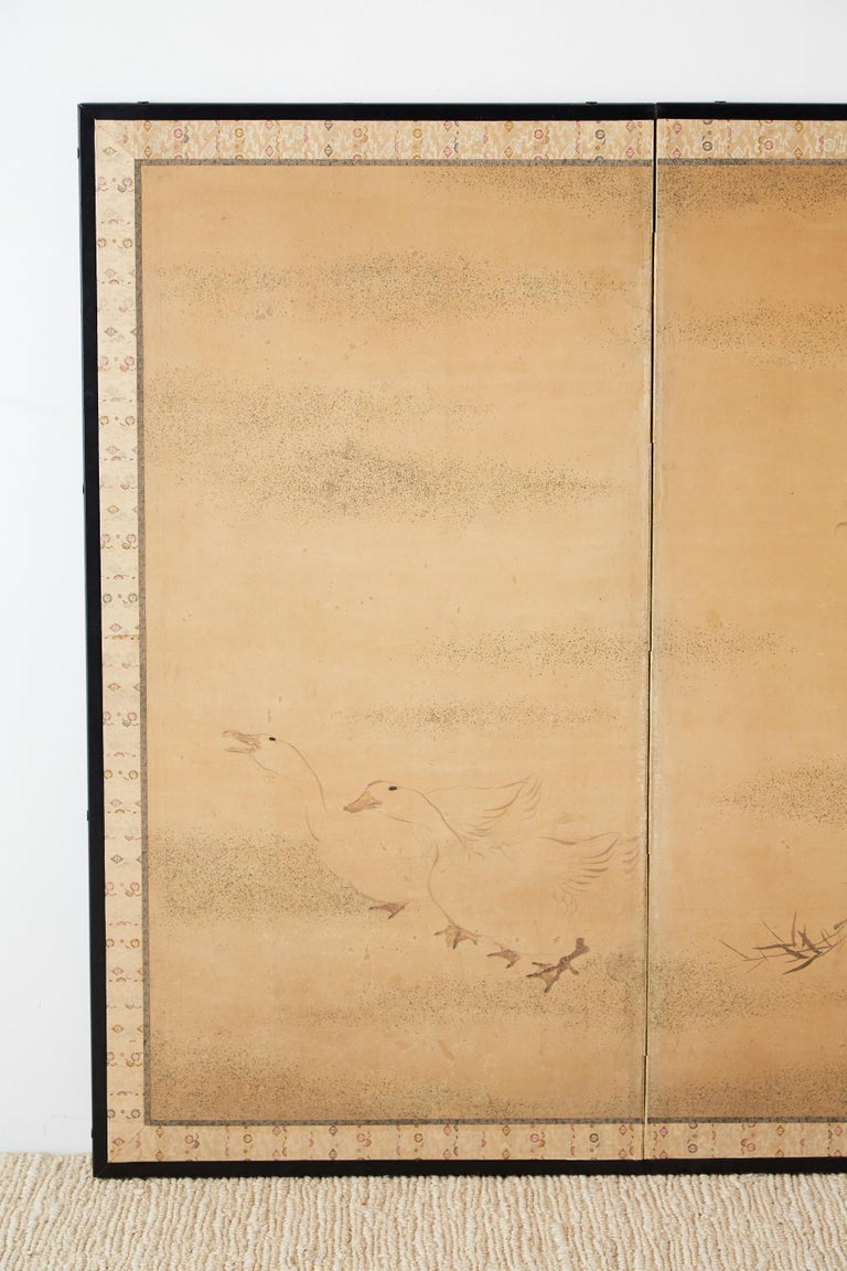 Ebonized Japanese Two Panel Screen of Child with Geese For Sale