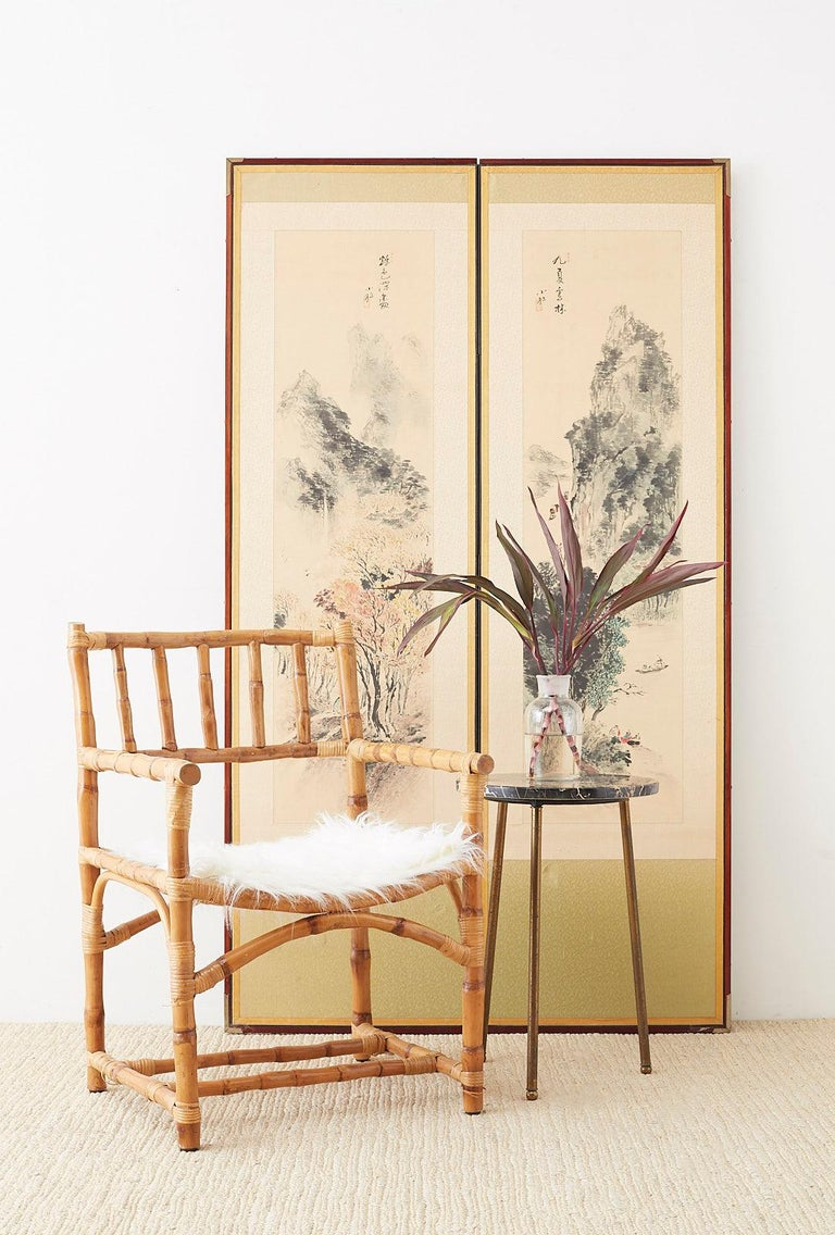 Unique Japanese two-panel screen depicting two painted landscapes of summer and autumn. Ink on color pigments each signed by artist with seals. Mounted to lacquered frames with silk borders. Paintings on textured paper measure 13 wide by 48 inches