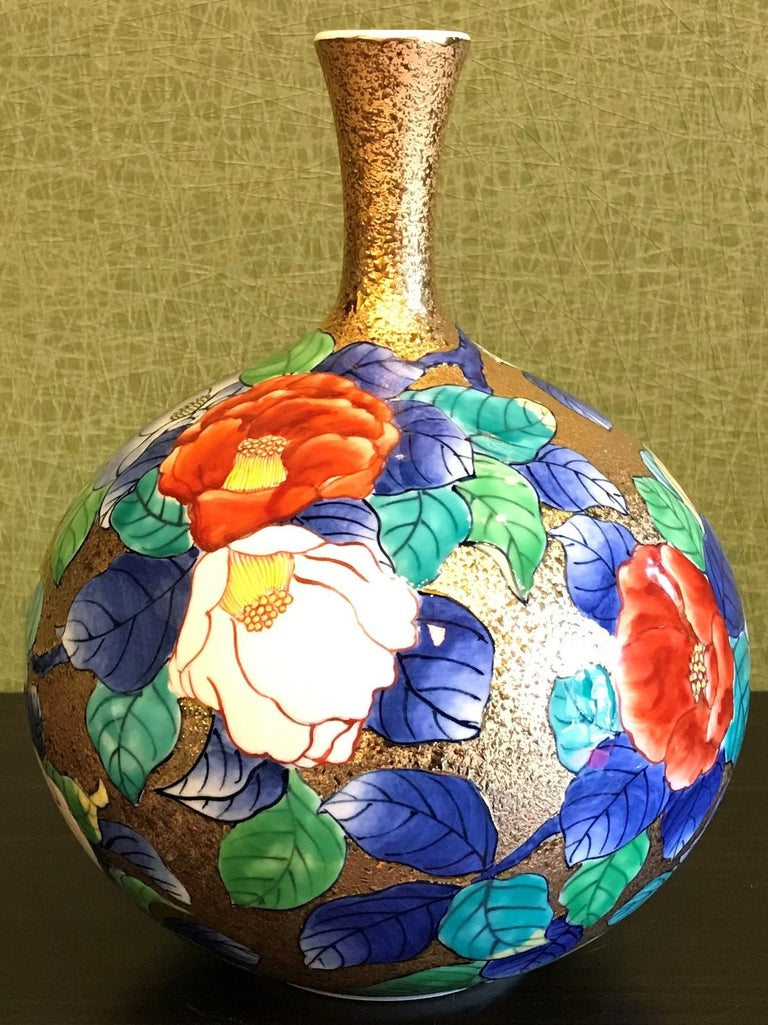 Contemporary gilded porcelain vase, hand painted on an attractive bottle shaped body with an elegant long neck. This stunning piece is the work of an acclaimed and award-winning master porcelain artist from the Imari-Arita region of Japan.