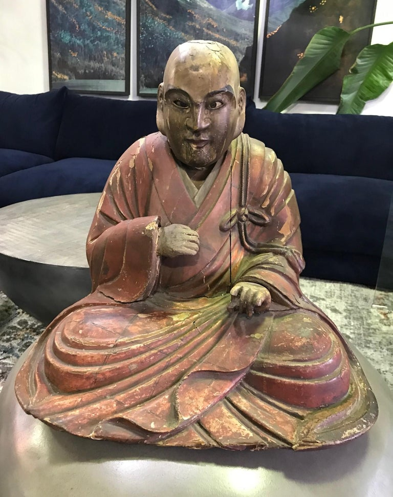 This is truly a wonderful piece with clear age and a nice patina to it. Very unique. We have not seen another quite like it. The monk appears to have glass eyes which gives his expression a very humanistic feel. The head is removable (please see the