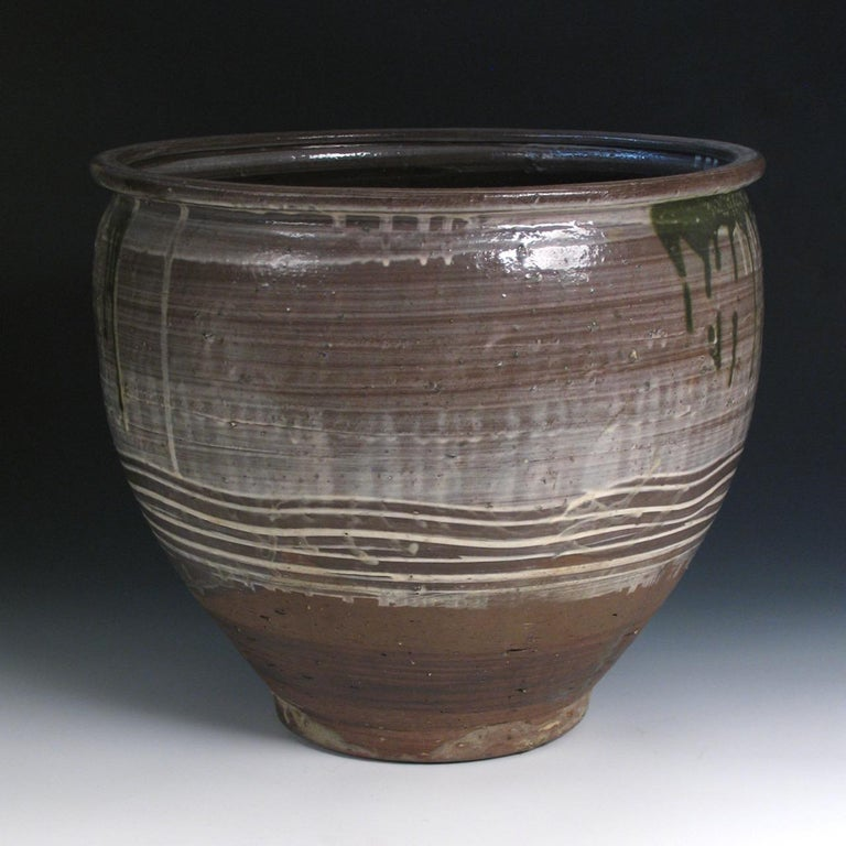 Japanese Yumino Wax Bean Storage Jar, northern Kyushu, Yumino kiln, well shaped and thickly potted stoneware jar, large well-rounded body with everted lip, lightly applied white slip with dripping copper-oxide green glaze with bottom section