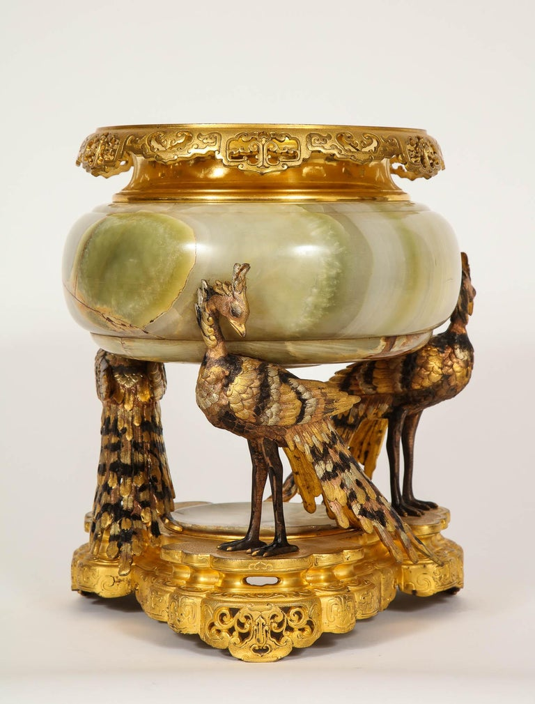 A beautiful French polychrome patinated dore bronze and silvered bronze with Algerian onyx mounted centerpiece, attributed to Eugene Cornu. This beautiful centerpiece was made in the