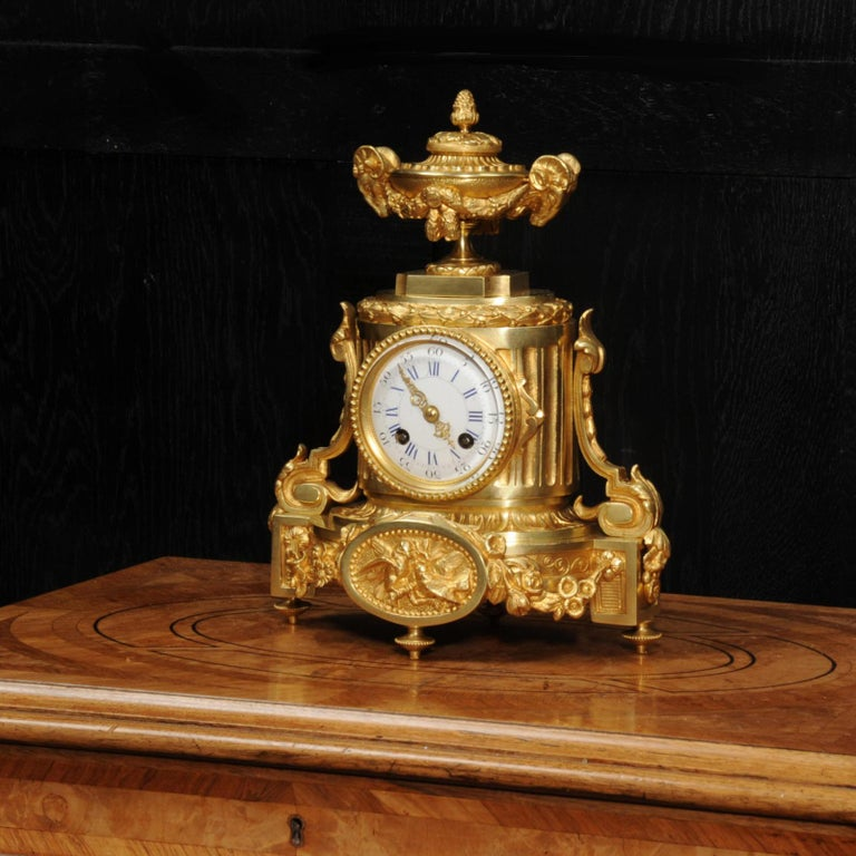 A superb Japy Frères antique French ormolu boudoir clock, circa 1860. It is classical in style with scrolls, acanthus panel with birds and a large urn with rams head handles to the top. The lid of the urn opens for storage of small items. The ormolu