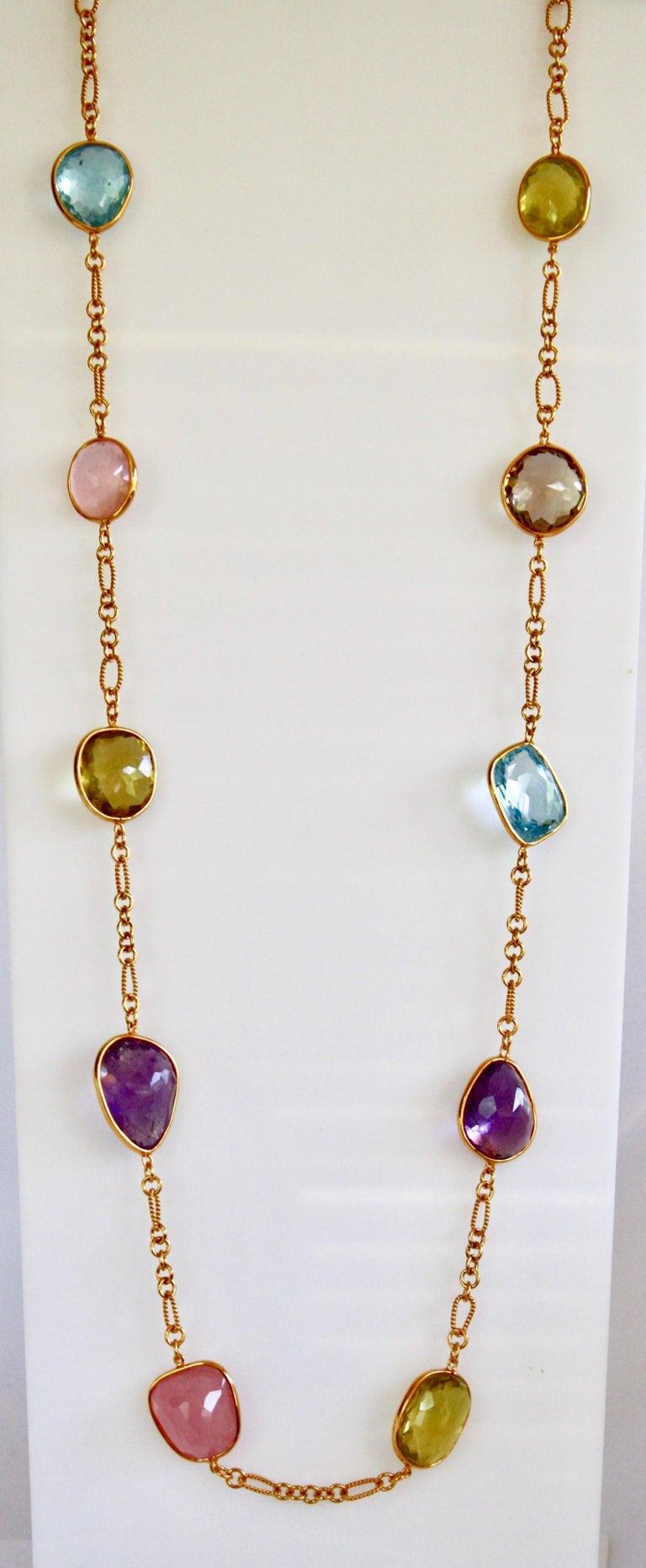 One of a kind Jarin K aquamarine, lemon quartz, smoky quartz, and pink quartz long necklace.