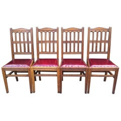 Jas Shoolbred Attributed a Set of Four Arts & Crafts Oak & Leather Dining Chairs