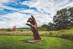 Inverted Left Hand - large, rust, figurative, corten steel outdoor sculpture