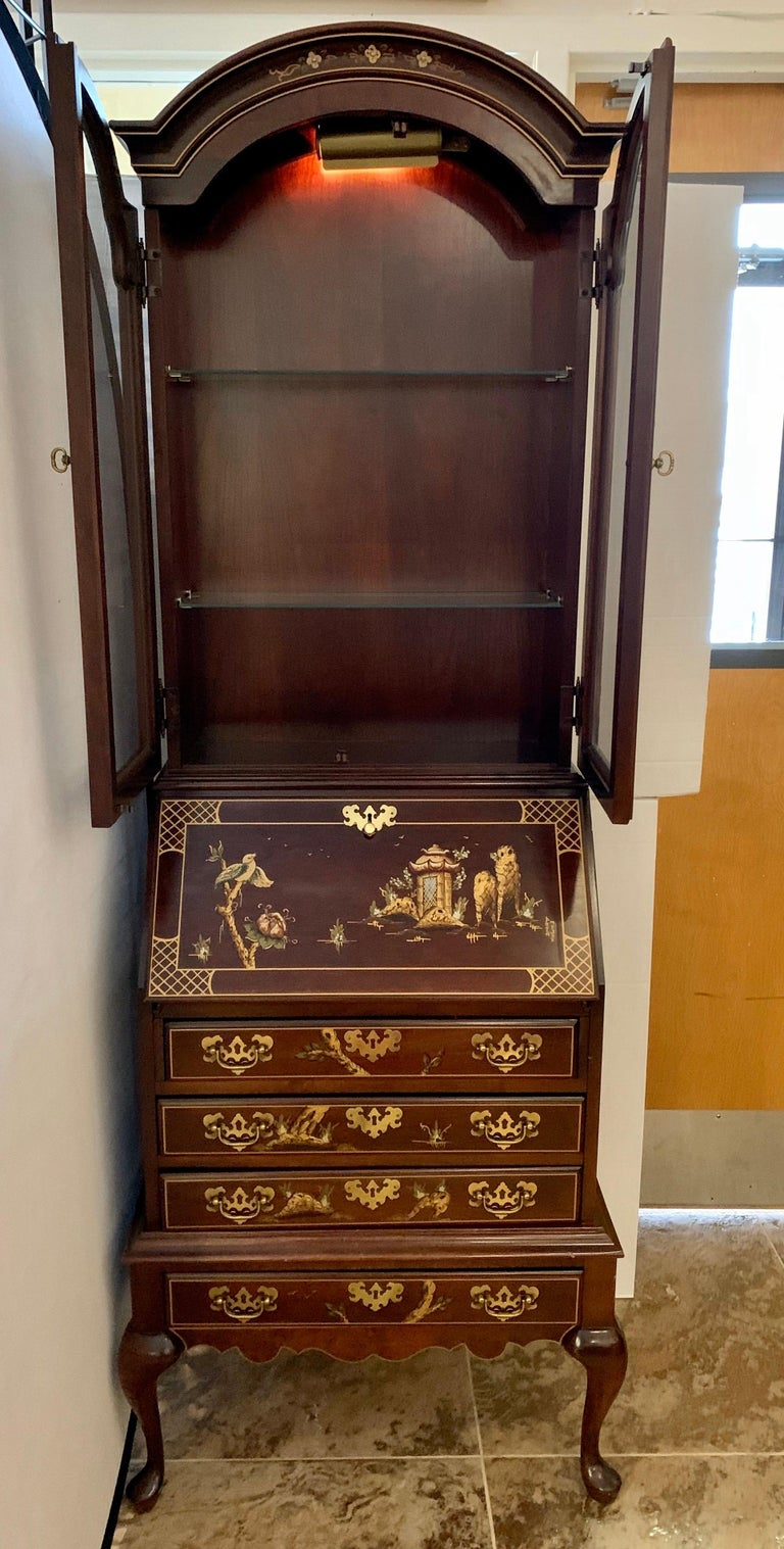 Iconic Jasper Furniture signed two-piece secretary cabinet which becomes multi-purpose piece when desk pulls down. Great brown chinoiserie color scheme.