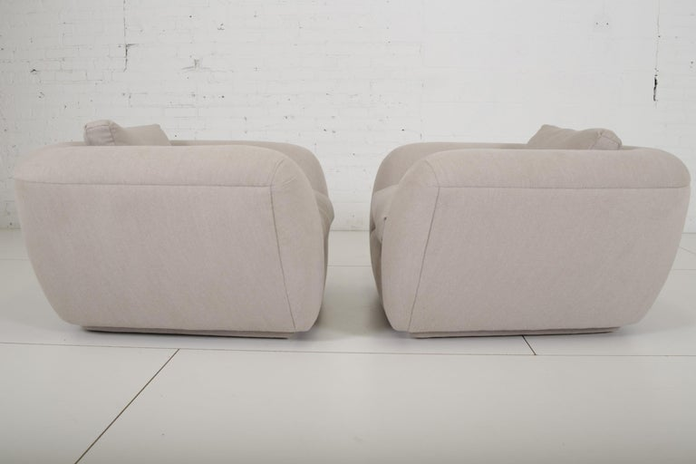 Pair of lounge chairs designed by Jay Spectre for a Chicago interior. Newly recovered in cashmere blend fabric over feather down fill. Very few of these special chairs were built and placed only with Spectre's clients.