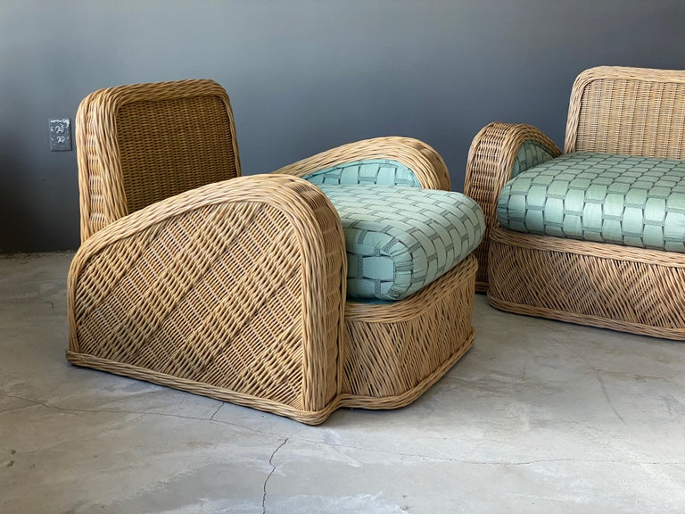 A pair of modernist lounge chairs designed by Jay Spectre. Produced in the 1980s, USA. Labeled. In intricately woven rattan.