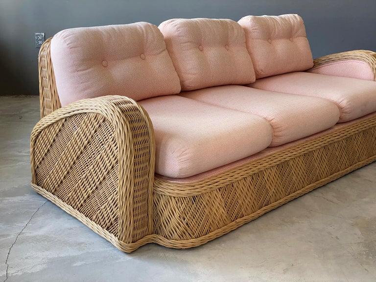 A modernist sofa designed by Jay Spectre. Produced in the 1980s, USA. Labeled. In intricately woven rattan.  Other designers of the period include Paul Frankl, T.H. Robsjohn-Gibbings, Paul Evans, Edward Wormley, and Tommi Parzinger.