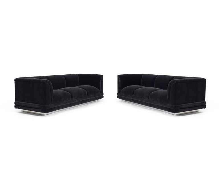 Pair of Jay Spectre sofas. Fully restored. Reupholstered in black mohair on polished chrome bases.  Priced individually.