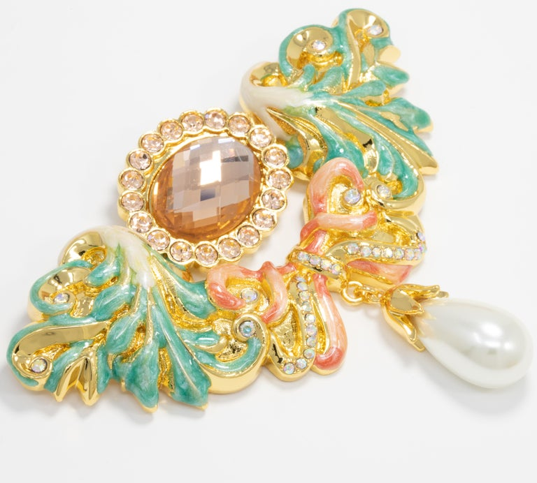 Stunning pin brooch from Jay Strongwater, painted with green and red enamel and accented with faceted crystals and a single dangling faux pearl.   Gold plated.  From Jay Strongwater's JAY line for HSN.  Hallmarks: Jay, Jay Strongwater, HSN