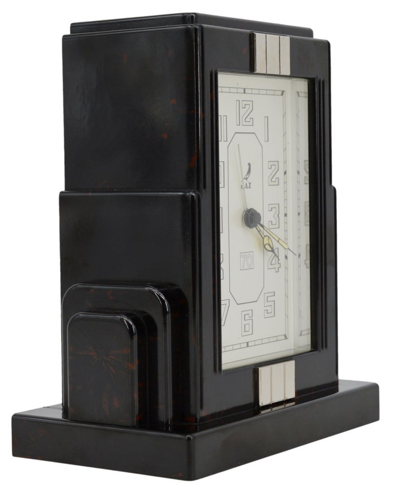 French Art Deco clock by JAZ, France, 1930s. Bakelite, metal and glass. Measures: Height: 6.4