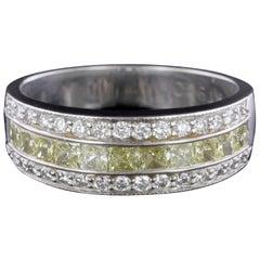 JB. Star Platinum and 18 Karat Yellow Gold Fancy Yellow Diamond and Diamond Ring