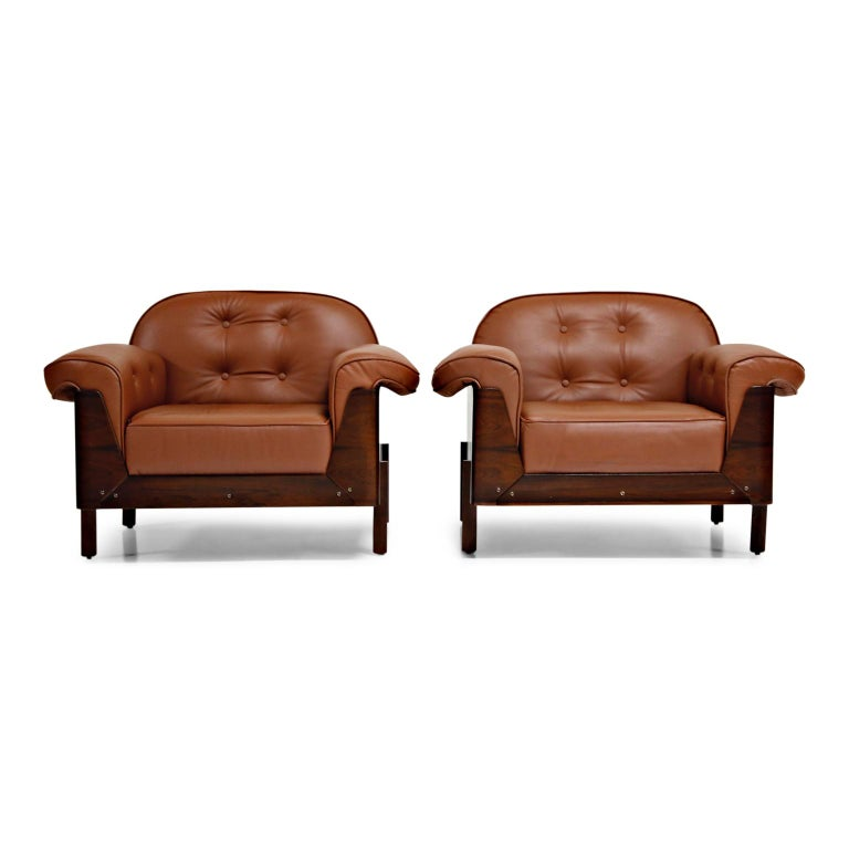 These, often attributed to Jorge Zalszupin, Jacaranda rosewood and leather lounge chairs were produced in the mid to late 1960s in Brazil by J.D Moveis, a producer of high-quality and small-batch artisan furniture (see last photo). We recently