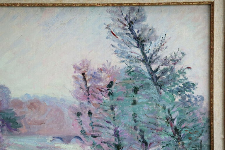 A simply beautiful oil on original canvas circa 1900 by Jean Baptiste Armand Guillaumin depicting a tree-lined river running through a snowy winter landscape, a cottage with smoke coming from its chimney in the distance. Signed lower left. Framed