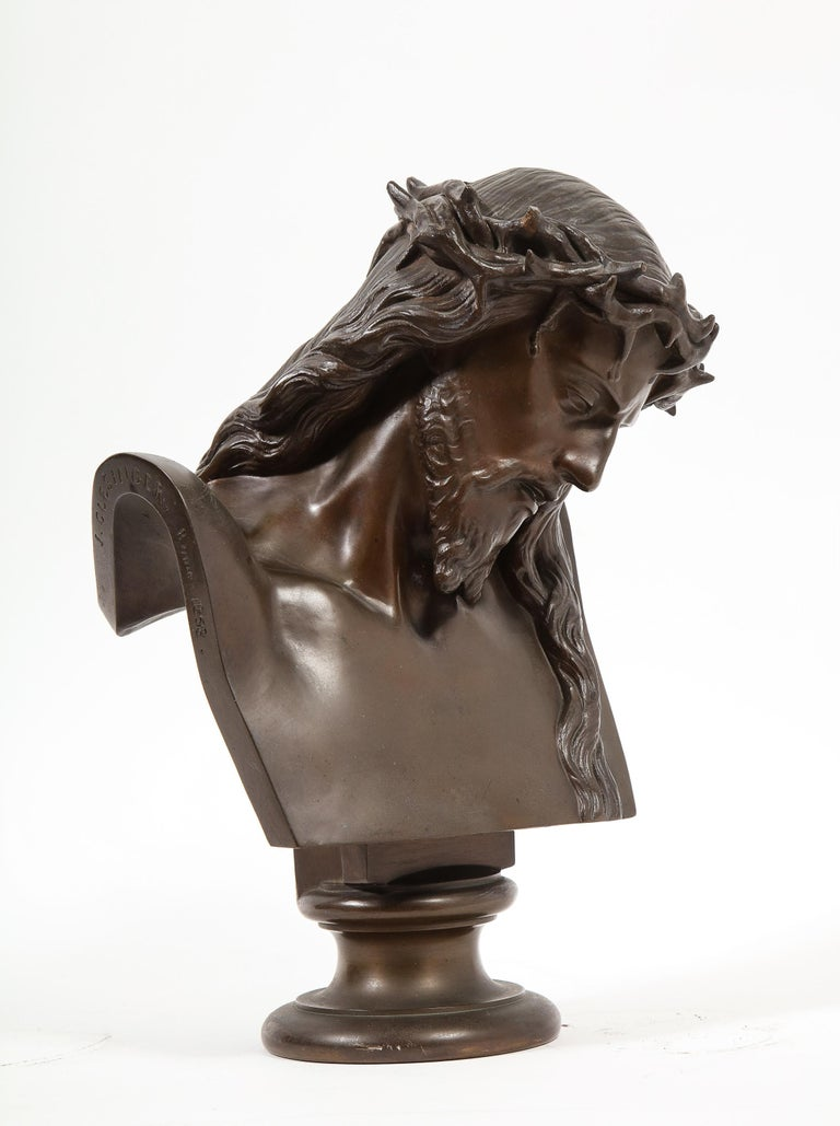 An exceptional French patinated realistic bronze bust of Jesus Christ, 1858.  Signed: J CLESINGER. Rome. 1858 with F. BARBEDIENNE FONDEUR, with the Reduction Mecanique seal.  Measures: 13