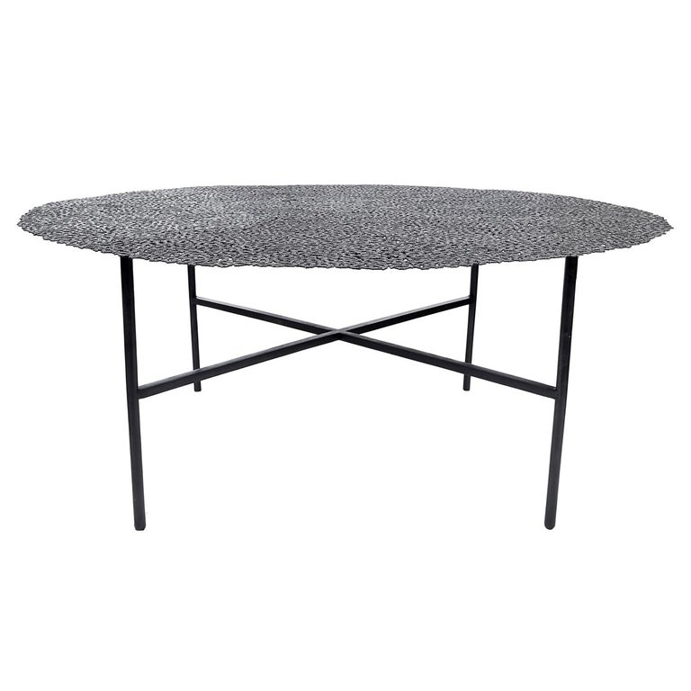 A swarm of butterflies as delicate as a lace table cloth forms an everlasting tabletop in blackened brass, lost wax cast by Italian master craftsmen. A sculptural table for both indoor and outdoor use.