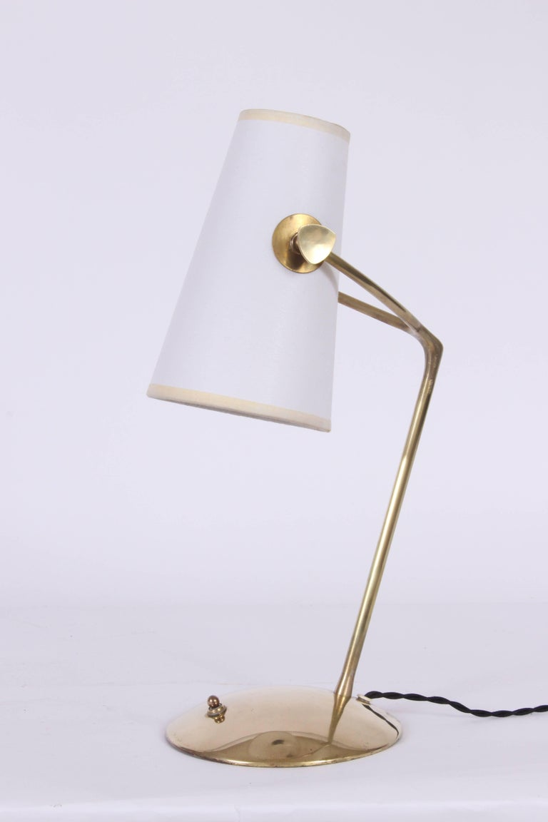 Boris Lacroix attributed brass bedside lamp with white paper shade. Fine brass wishbone form with replaced white paper shade. Measures: (Shade 8H x 3D top and 5D bottom). Elegant. French. Organic modern. Rewired with black braided cloth cord.