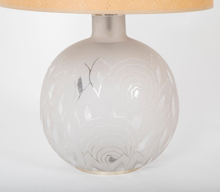 A wornderfully exicuted acid etched glass lamp with nickle plated mounts byJean Boris Lacroix ( France., 1902 - 1984 ). The attention to detail carrys on to the etched signature and asemetrical mounting on the base. The lamp is dated 1929 and has